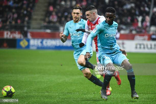 Lucas Ocampos of Marseille Mathieu Cafaro of Reims and Bouna Sarr of Marseille during the Ligue 1 match between Reims and Marseille at Stade Auguste...