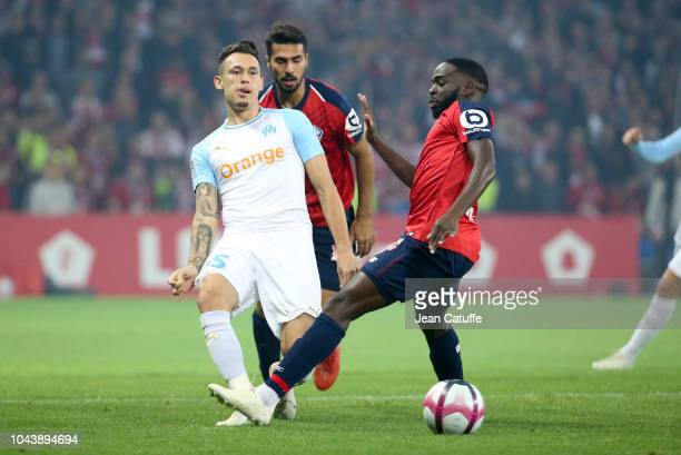 Lucas Ocampos of Marseille Mehmet Celik and Yves Dabila of Lille during the french Ligue 1 match between Lille OSC and Olympique de Marseille at...