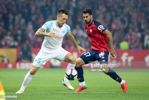 Lucas Ocampos of Marseille Mehmet Celik of Lille during the french Ligue 1 match between Lille OSC and Olympique de Marseille at Stade Pierre Mauroy...