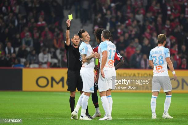 Lucas Ocampos of Marseille receives a yellow card from referee Mikael Lesage during the Ligue 1 match between Lille OSC and Marseille at Stade Pierre...