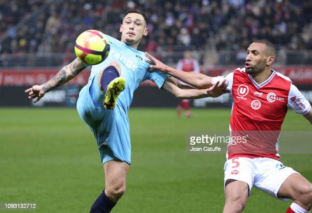 Lucas Ocampos of Marseille Yunis Abdelhamid of Reims during the french Ligue 1 match between Stade de Reims and Olympique de Marseille at Stade...