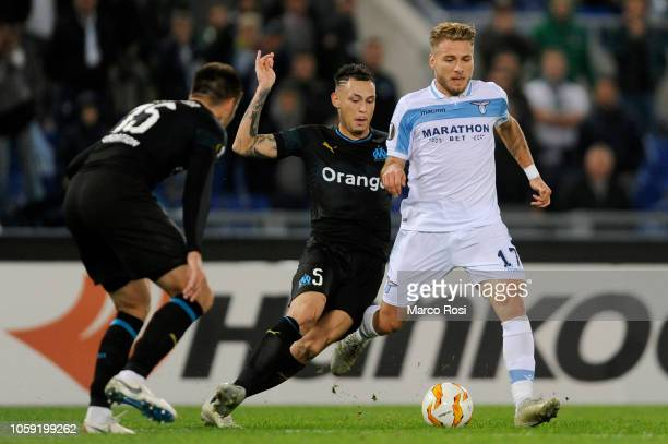 Lucas Ocampos of Olympique de Marseille compete for the ball with Ciuro Immobile of SS Lazio during the UEFA Europa League Group H match between SS...