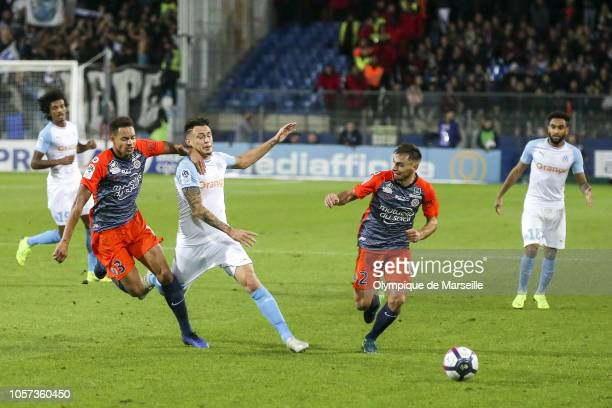 Lucas Ocampos of Olympique de Marseille fights for the ball during the Ligue 1 match between Montpellier and Marseille at Stade de la Mosson on...