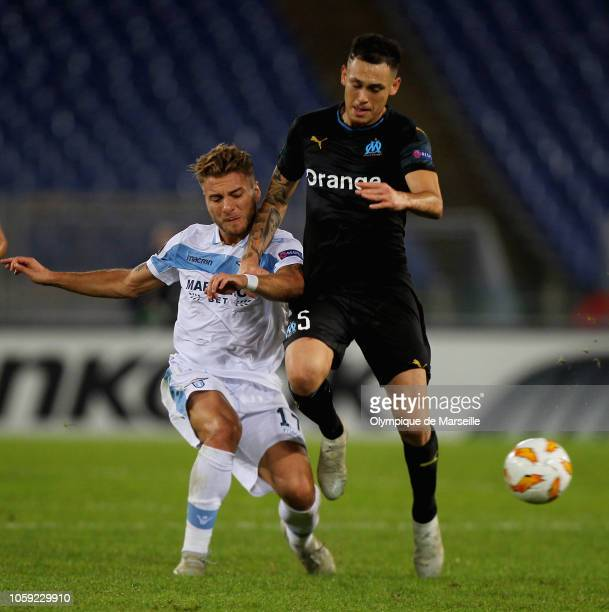 Lucas Ocampos of Olympique de Marseille in action with Ciro Immobile of SS Lazio during the UEFA Europa League Group H match between SS Lazio and...