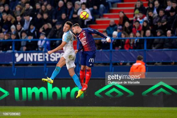 Lucas Ocampos of Olympique de Marseille jumps for the ball during the Ligue 1 match between SM Caen and Olympique de Marseille at Stade Michel...
