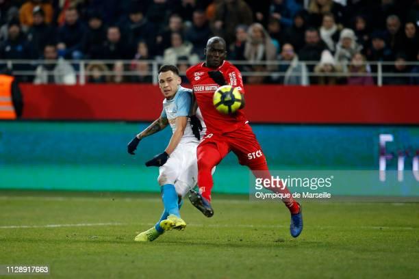 Lucas Ocampos of Olympique de Marseille kicks the ball during the Ligue 1 match between Olympique de Marseille and Dijon FCO at Stade Gaston Gerard...