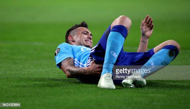 Lucas Ocampos of Olympique Marseille lies on the pitch during the UEFA Europa League quarter final leg one match between RB Leipzig and Olympique...