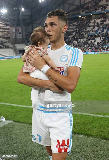 Lucas Ocampos of OM holds his daughter Luisana Ocampos after the French Ligue 1 match between Olympique de Marseille and Troyes ESTAC at New Stade...