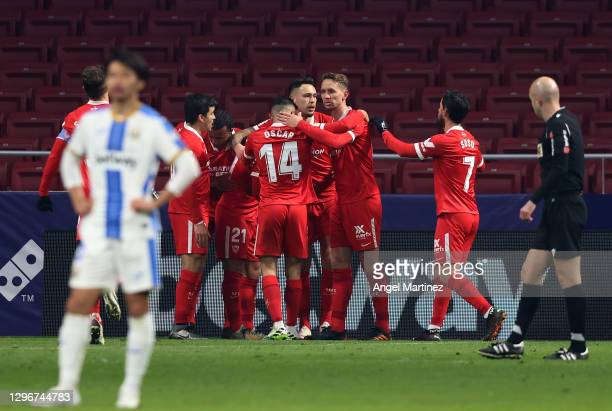 Lucas Ocampos of Sevila FC celebrates with team mates after scoring the opening goal during the Copa del Rey Round of 32 match between CD Leganes and...