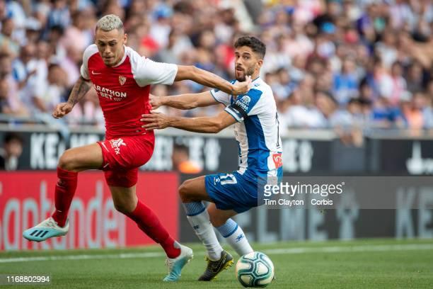 Lucas Ocampos of Sevilla and Didac Vila of Espanyol challenge for the ball during the Espanyol V Sevilla FC La Liga regular season match at RCDE...