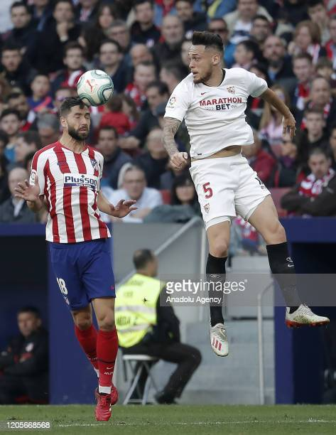 Lucas Ocampos of Sevilla and Felipe of Atletico Madrid vie for the ball during the La Liga week 27 match between Atletico Madrid and Sevilla at Wanda...