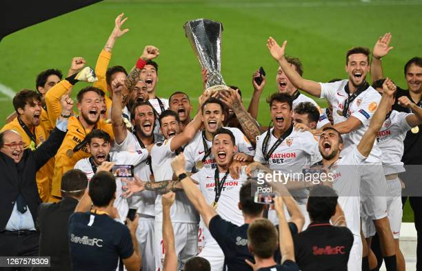 Lucas Ocampos of Sevilla and his teammates lift the UEFA Europa League Trophy following their team's victory in the UEFA Europa League Final between...