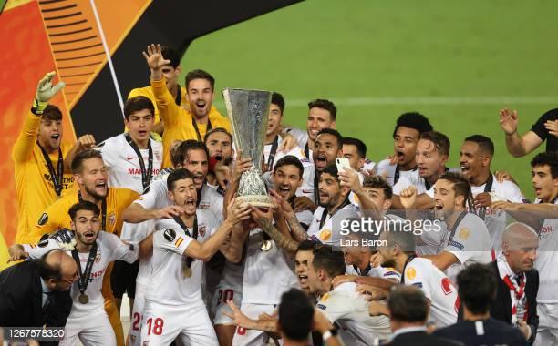 Lucas Ocampos of Sevilla and his teammates lift the UEFA Europa League Trophy following their team's victory in the UEFA Europa League Final between...