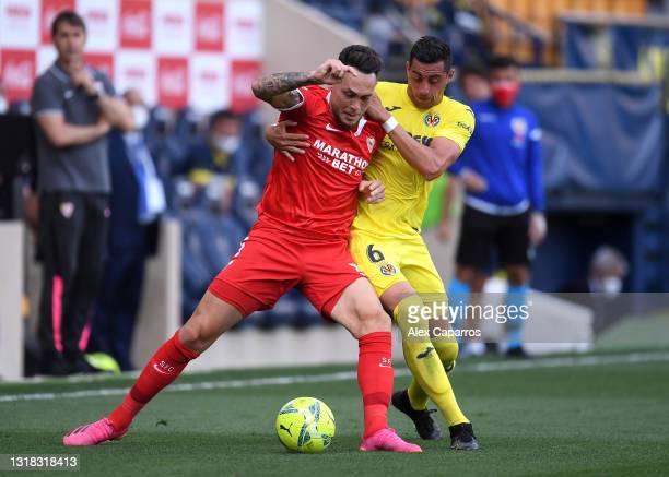 Lucas Ocampos of Sevilla battles for possession with Ramiro Funes Mori of Villarreal CF during the La Liga Santander match between Villarreal CF and...
