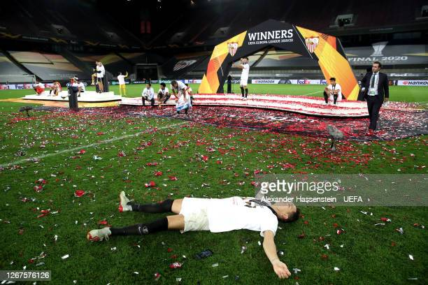 Lucas Ocampos of Sevilla celebrates on the pitch following his team's victory in the UEFA Europa League Final between Seville and FC Internazionale...
