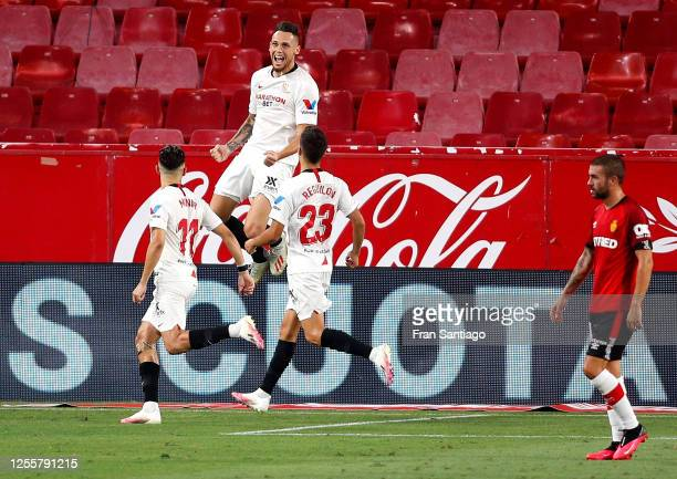 Lucas Ocampos of Sevilla celebrates with Munir El Haddadi and Sergio Reguilon after scoring his team's first goal during the La Liga match between...