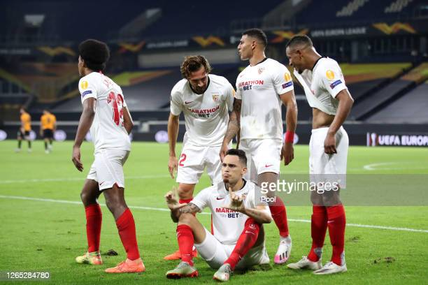 Lucas Ocampos of Sevilla celebrates with teammates after scoring his sides first goal during the UEFA Europa League Quarter Final between Wolves and...