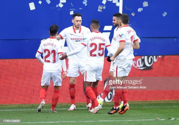 Lucas Ocampos of Sevilla celebrates with teammates after scoring his team's first goal during the La Liga Santander match between SD Eibar and...