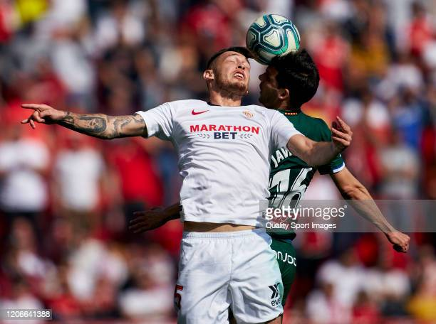 Lucas Ocampos of Sevilla competes for the ball with Javi Lopez of Espanyol during the Liga match between Sevilla FC and RCD Espanyol at Estadio Ramon...