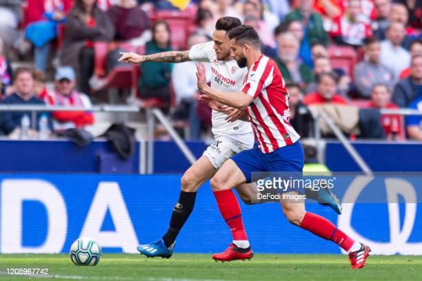Lucas Ocampos of Sevilla FC and Felipe Augusto de Almeida of Atletico de Madrid battle for the ball during the Liga match between Club Atletico de...