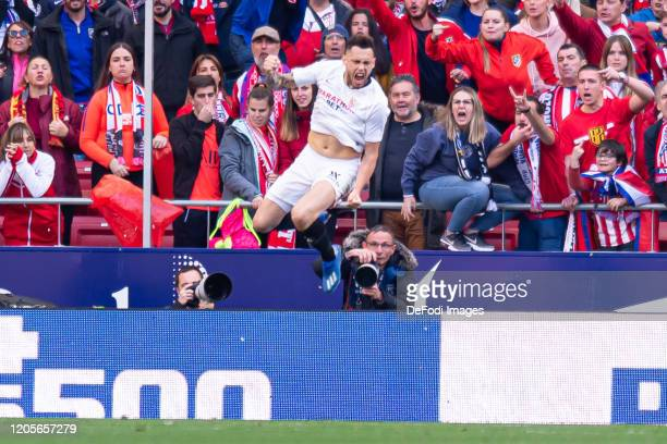 Lucas Ocampos of Sevilla FC celebrates after scoring his team's second goal during the Liga match between Club Atletico de Madrid and Sevilla FC at...