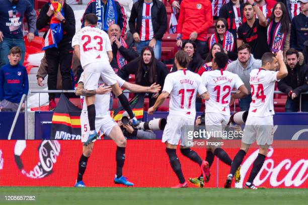 Lucas Ocampos of Sevilla FC celebrates after scoring his team's second goal with teammates during the Liga match between Club Atletico de Madrid and...