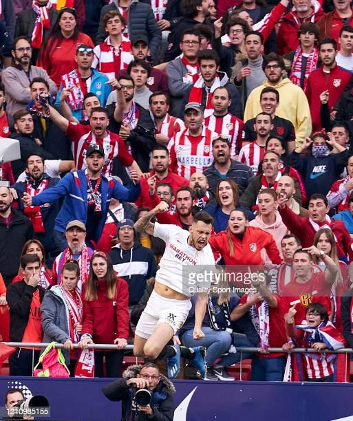 Lucas Ocampos of Sevilla FC celebrates after scoring his team's second goalduring the Liga match between Club Atletico de Madrid and Sevilla FC at...