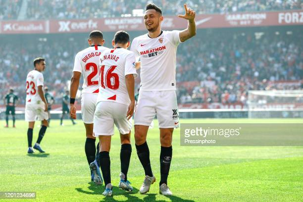 Lucas Ocampos of Sevilla FC celebrates after scoring the 10 with his teammate Jesus Navas during the Liga match between Sevilla FC and RCD Espanyol...