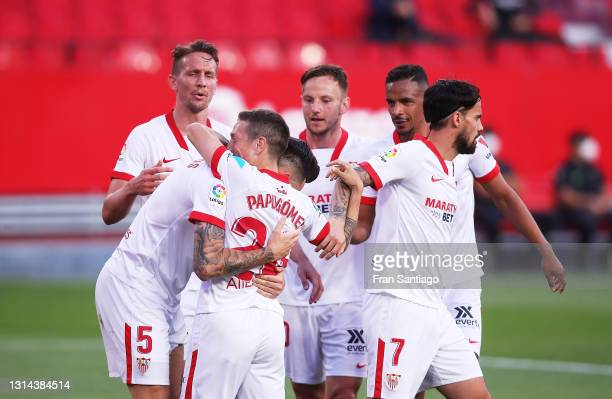 Lucas Ocampos of Sevilla FC celebrates scoring a goal with team mates during the La Liga Santander match between Sevilla FC and Granada CF at Estadio...