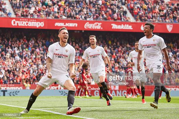 Lucas Ocampos of Sevilla FC celebrates scoring his team's second goal with team mates during the Liga match between Sevilla FC and CA Osasuna at...