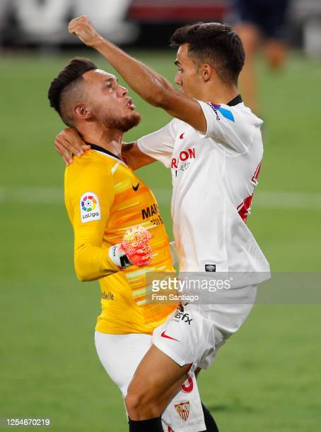 Lucas Ocampos of Sevilla FC celebrates with his team mate Sergio Reguilon of Sevilla FC at the end of the Liga match between Sevilla FC and SD Eibar...