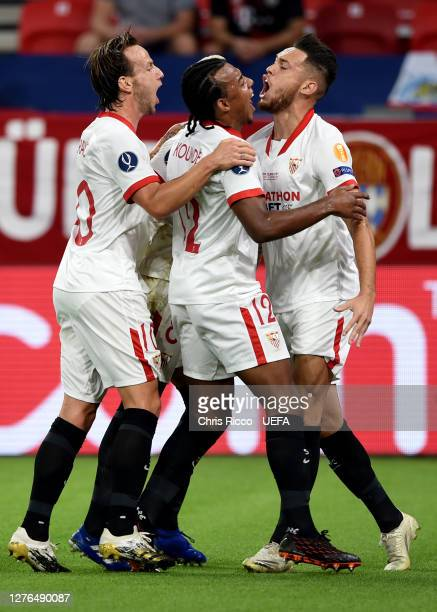 Lucas Ocampos of Sevilla FC celebrates with his team mates after scoring his team's first goal during the UEFA Super Cup match between FC Bayern...