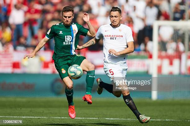 Lucas Ocampos of Sevilla FC competes for the ball with Adrian Giner Pedrosa of RCD Espanyol during the Liga match between Sevilla FC and RCD Espanyol...