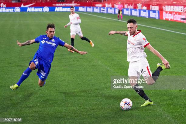 Lucas Ocampos of Sevilla FC competes for the ball with Damian Suarez of Getafe CF during the La Liga Santander match between Sevilla FC and Getafe CF...
