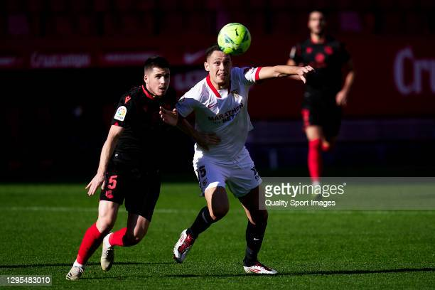 Lucas Ocampos of Sevilla FC competes for the ball with Igor Zubeldia of Real Sociedad during the La Liga Santander match between Sevilla FC and Real...