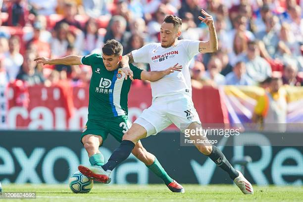 Lucas Ocampos of Sevilla FC competes for the ball with Victor Gomez of RCD Espanyol during the Liga match between Sevilla FC and RCD Espanyol at...
