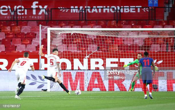 Lucas Ocampos of Sevilla FC fails to score from the penalty spot as Jan Oblak of Atletico Madrid saves the shot during the La Liga Santander match...
