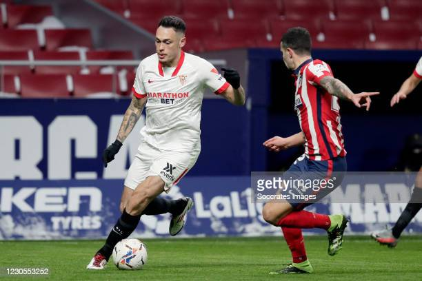 Lucas Ocampos of Sevilla FC, Mario Hermoso of Atletico Madrid during the La Liga Santander match between Atletico Madrid v Sevilla at the Estadio...