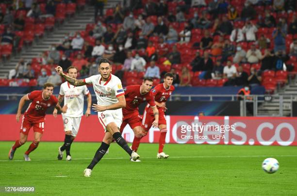 Lucas Ocampos of Sevilla FC scores his team's first goal from the penalty spot during the UEFA Super Cup match between FC Bayern Munich and FC...