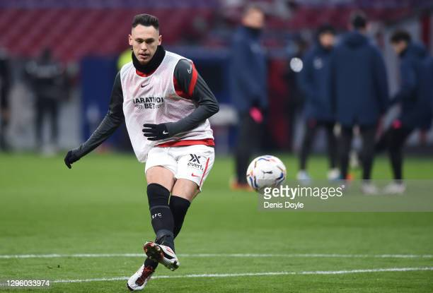 Lucas Ocampos of Sevilla FC shoots as he warms up prior to the La Liga Santander match between Atletico de Madrid and Sevilla FC at Estadio Wanda...