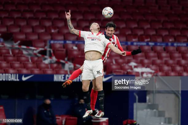 Lucas Ocampos of Sevilla FC, Stefan Savic of Atletico Madrid during the La Liga Santander match between Atletico Madrid v Sevilla at the Estadio...