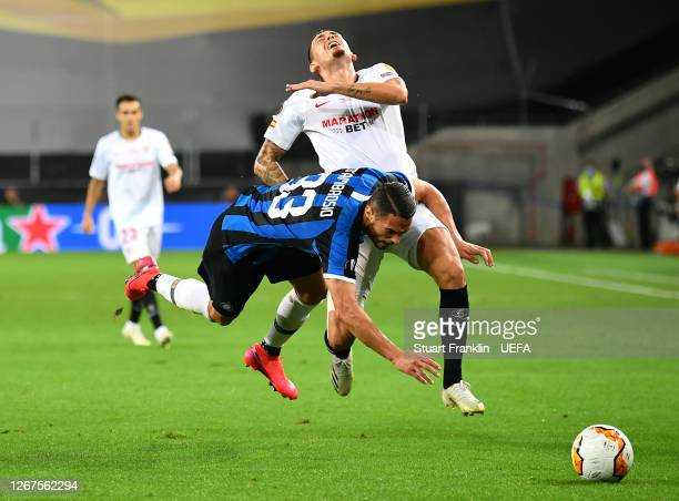 Lucas Ocampos of Sevilla is challenged by Danilo D'Ambrosio of Inter Milan during the UEFA Europa League Final between Seville and FC Internazionale...