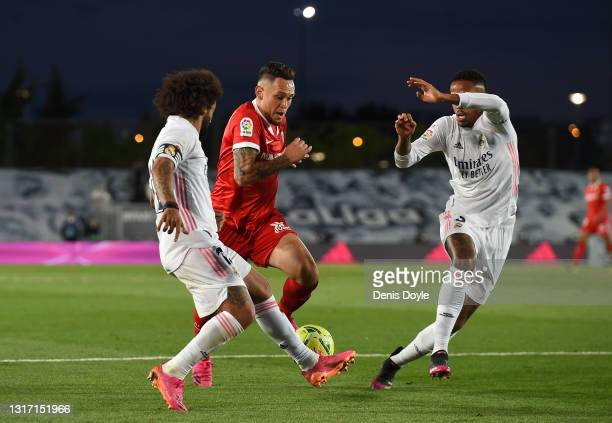 Lucas Ocampos of Sevilla is challenged by Marcelo of Real Madrid during the La Liga Santander match between Real Madrid and Sevilla FC at Estadio...