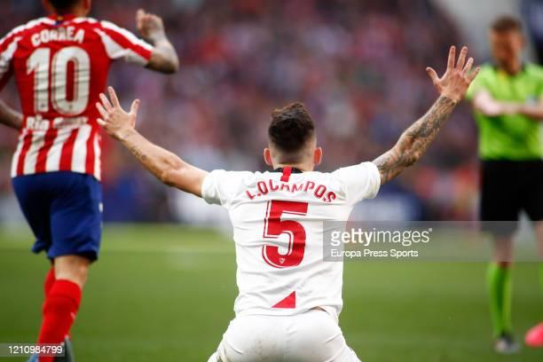 Lucas Ocampos of Sevilla protest during the Spanish League La Liga football match played between Atletico de Madrid and Sevilla FC at Wanda...