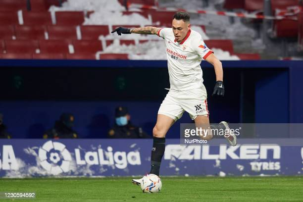 Lucas Ocampos of Sevilla runs with the ball during the La Liga Santander match between Atletico de Madrid and Sevilla FC at Estadio Wanda...