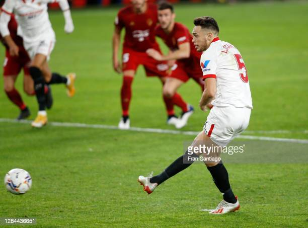Lucas Ocampos of Sevilla scores a penalty for his team's first goal during the La Liga Santander match between Sevilla FC and C.A. Osasuna at Estadio...