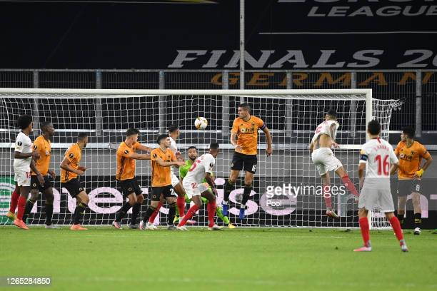 Lucas Ocampos of Sevilla scores his sides first goal during the UEFA Europa League Quarter Final between Wolves and Sevilla at MSV Arena on August...