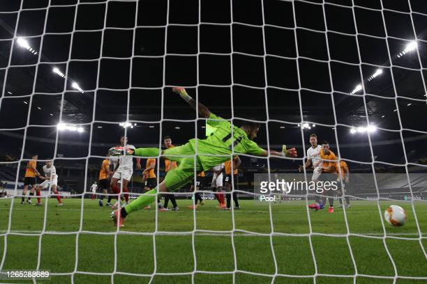 Lucas Ocampos of Sevilla scores his sides first goal past Rui Patricio of Wolverhampton Wanderers during the UEFA Europa League Quarter Final between...