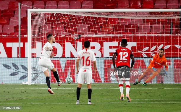 Lucas Ocampos of Sevilla scores his team's first goal from the penalty spot during the La Liga match between Sevilla FC and RCD Mallorca at Estadio...