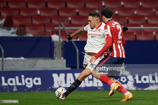 Lucas Ocampos of Sevilla shooting to goal front Jose Maria Gimenez of Atletico Madrid during the La Liga Santander match between Atletico de Madrid...